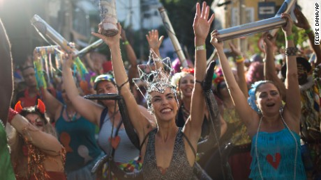 "Revelers dance during the Ceu na Terra, or 'Heaven on Earth' carnival street party in Rio de Janeiro, Brazil, Saturday, Feb. 18, 2017. Merrymakers take to the streets in hundreds of open-air ""bloco"" parties ahead of Rio's over-the-top Carnival, the highlight of the year for many. (AP Photo/Felipe Dana)"