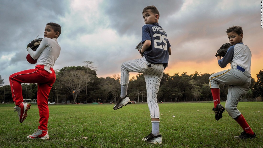 <strong>Havana:</strong> Cuban children limber up during a baseball training session in Havana in February. Baseball is one of the country's most popular sports. <br />