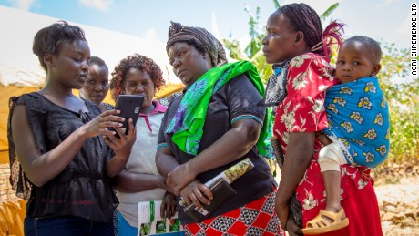 Women farmers learn to use the Mbego choice app in Kenya.