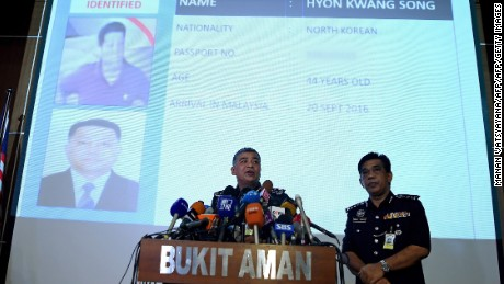 Royal Malaysian Police chief Khalid Abu Bakar (L) addresses journalists in front of a screen displaying the details of North Korean Embassy staff Hyon Kwong Song, who has been identified for questioning, during a press conference at the Bukit Aman police headquarters in Kuala Lumpur on February 22, 2017, following the assassination of Kim Jong-Nam, the half brother of North Korean leader Kim Jong-Un. 
