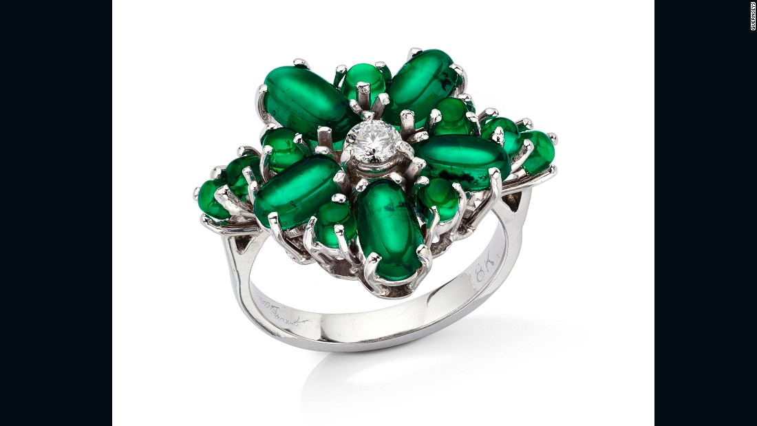In creating this ring, Marcial de Gomar combined several rare cat's eye Muzo emeralds with diamonds and white gold.