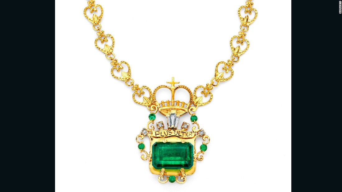 "This Marcial de Gomar-designed necklace features a 24.34 carat Muzo emerald salvaged from the Spanish shipwreck Nuestra Señora de Atocha. Baguette and round-cut diamonds and emeralds further enhance the central pendant, which bears the words ""Plus Ultra,"" a reference to the Spanish history of conquest and the motto of the Colombian Marines."