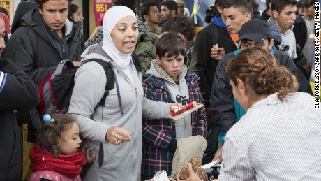 Food and drink is distributed by volunteers to refugees that arrived at Malmoe train station in Malmoe, Sweden in the morning of September 10, 2015. AFP PHOTO / TT NEWS AGENCY / OLA TORKELSSON  +++ SWEDEN OUT +++        (Photo credit should read OLA TORKELSSON/AFP/Getty Images)