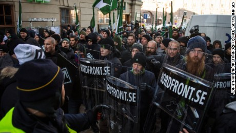Members of the neo-nazi Nordic Resistance Movement hold an anti-migrant protest in Stockholm.