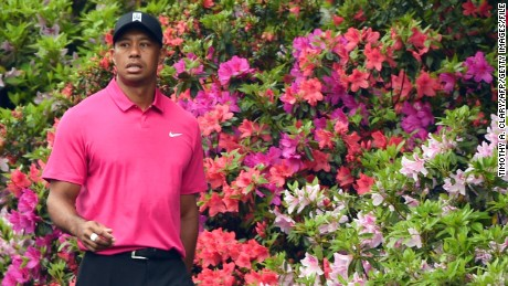 Tiger Woods of the US walks past blooming azaleas April 7, 2015 at Augusta National Golf Club in Augusta, Georgia during a practice round for the 2015 Masters Golf Tournament.  AFP PHOTO /  TIMOTHY  A. CLARY        (Photo credit should read TIMOTHY A. CLARY/AFP/Getty Images)