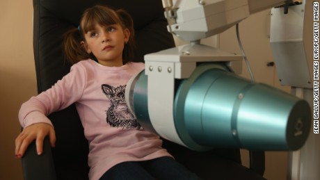 IVANKIV, UKRAINE - APRIL 01:  Anzhel Poleshchuk, 7, undergoes screening for the presence of certain radionucleides, including caesium-137, in her body as part of onging screening of local children at the polyclinic on April 1, 2016 in Ivankiv, Ukraine. Ivankiv district, an area inhabited by approximately 30,000 people, lies just south of the Chernobyl Exclusion Zone, and researchers have found significantly higher rates of immune system deficiencies and heart rhythm disorders among children, higher rates of circulatory disease among adults and a high rate of death among working-age adults, especially due to cardovascular disease, than compared to Kiev region farther south and compared to years before the 1986 Chernobyl nuclear disaster. Ivankiv district also shows a 100-fold increase in thyroid cancer rates from 1985-2010. Doctor Yuriy Bandazhevsky, who has led much of the research, sees caesium-137 released from the Chernobyl accident as the biggest threat, and says that local people get it into their bodies through food grown in the area and summer forest fires that release the radioactive isotope into the air.  (Photo by Sean Gallup/Getty Images)