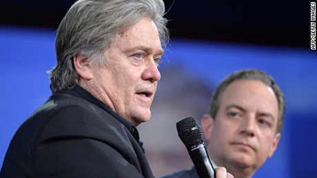 White House advisor Steve Bannon (L) makes remarks as White House Chief of Staff Reince Preibus listens during a discussion at the Conservative Political Action Conference (CPAC) at National Harbor, Maryland, February 23, 2017.