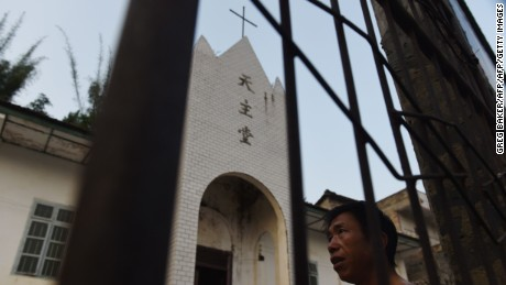 This photo taken on May 11, 2016 shows a villager outside the Catholic church in Changjing, in China's southern Guangxi region. The finishing touches are being put to a new museum in Dingan, the village where French missionary Auguste Chapdelaine died in 1856 and just a few kilometres from Changjing where he lived, celebrating the patriotism of his execution and condemning the spiritual opium of religion. / AFP / GREG BAKER / TO GO WITH China-culture-religion-Roman-Catholic-politics,FEATURE by Benjamin Carlson        (Photo credit should read GREG BAKER/AFP/Getty Images)