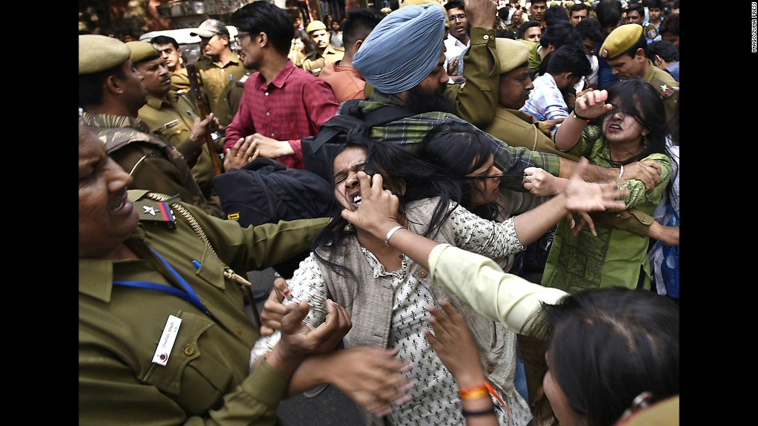Police try to break up fights between student activists in New Delhi on Wednesday, February 22.