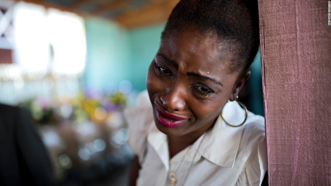 "A woman cries near the coffin of a relative who died at the largest prison in Port-au-Prince, Haiti, on Tuesday, February 21. Flowers were placed on 20 caskets during a mass funeral for inmates who, <a href=""https://www.yahoo.com/news/mass-funeral-held-20-haitians-died-dismal-prison-171114172.html"" target=""_blank"">according to the Associated Press,</a> died miserably in the overcrowded National Penitentiary."