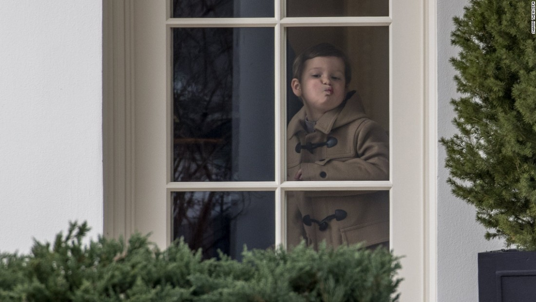 Joseph Kushner, a grandson of US President Donald Trump, looks out of the White House Oval Office before boarding Marine One on Friday, February 17. Kushner is the son of Jared Kushner, one of Trump's senior advisers.