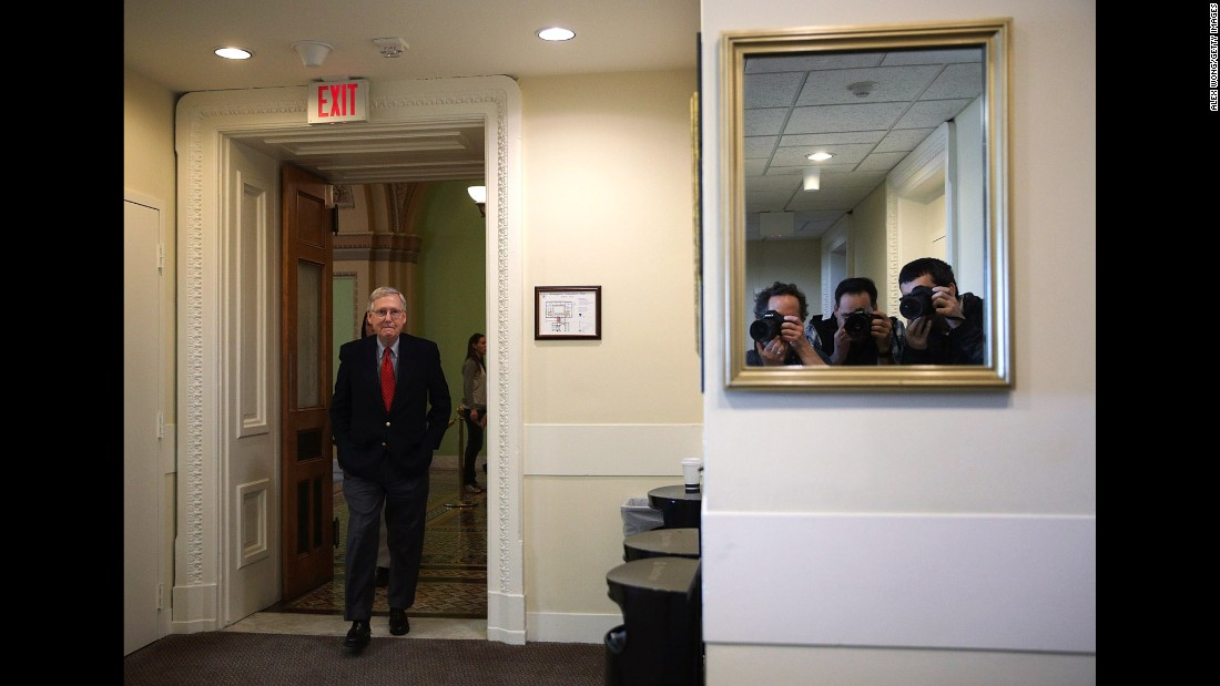Senate Majority Leader Mitch McConnell arrives for a news conference at the US Capitol in Washington on Friday, February 17.