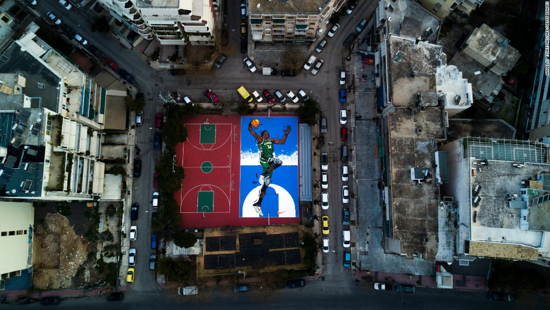 A basketball court in Athens, Greece, is painted with a mural of NBA All-Star Giannis Antetokounmpo on Sunday, February 19. Antetokounmpo was born in Athens.