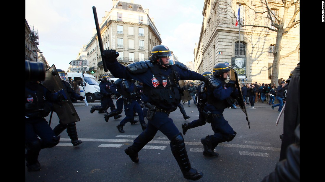 "Police officers charge on demonstrators as an anti-police protest turned violent in Paris on Saturday, February 18. People <a href=""http://www.cnn.com/2017/02/16/europe/paris-anti-police-protests/"" target=""_blank"">gathered in the French capital</a> to protest the alleged rape of a 22-year-old black man by police."