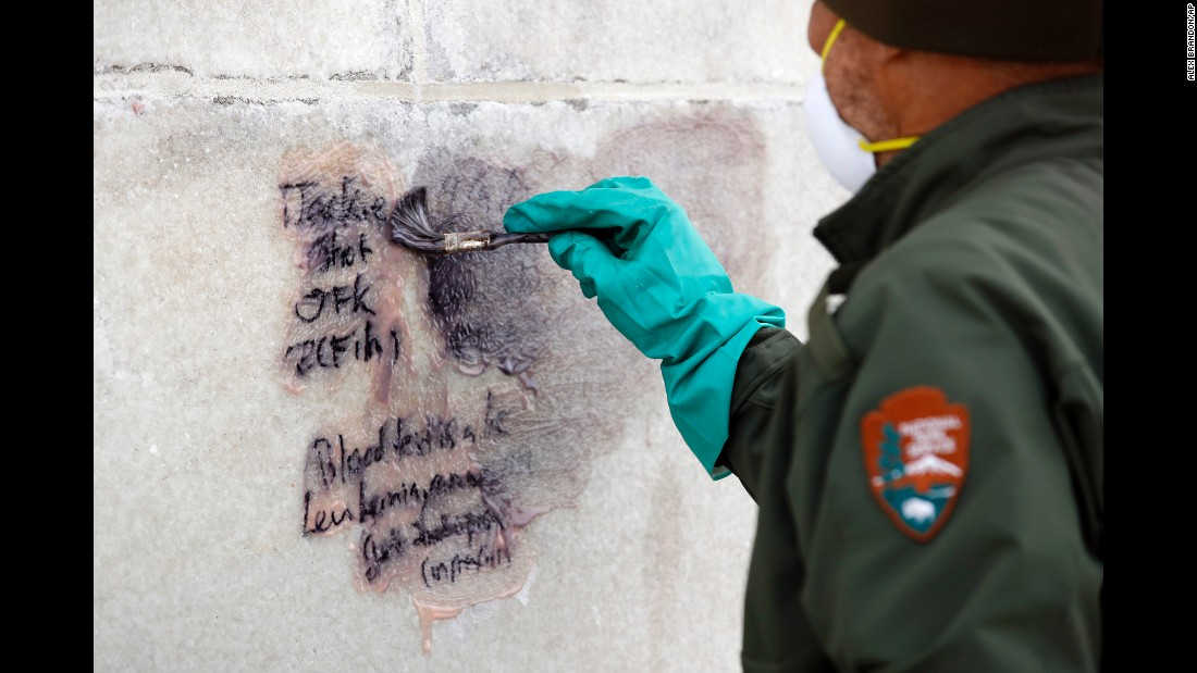 "A US Park Service employee cleans graffiti off the Washington Monument on Tuesday, February 21. <a href=""http://www.cnn.com/2017/02/21/us/graffiti-national-mall/"" target=""_blank"">Several instances of bizarre, conspiratorial graffiti</a> were found over the weekend at the Lincoln Memorial, the Washington Monument and the World War II Memorial, officials said."