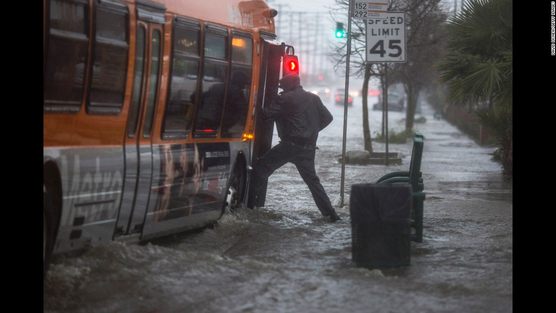 "A man boards a bus on a flooded street in Sun Valley, California, on Friday, February 17. Torrential downpours <a href=""http://www.cnn.com/2017/02/17/us/southern-california-storm-oroville-dam/"" target=""_blank"">were inundating Southern California,</a> flooding streets and prompting water rescues."