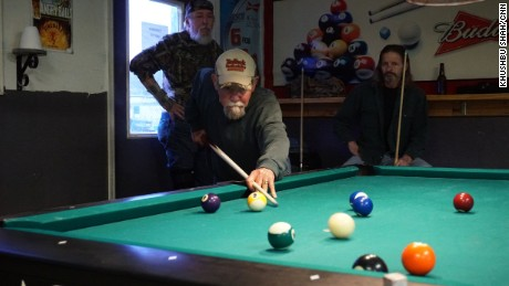 Retired workers from the nearby power plants shoot pool in Manchester's one bar, Bottoms Up.