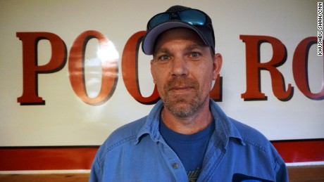 Chuck Shelton, a longtime employee at the Killen plant, has five kids and worries about his family's future.