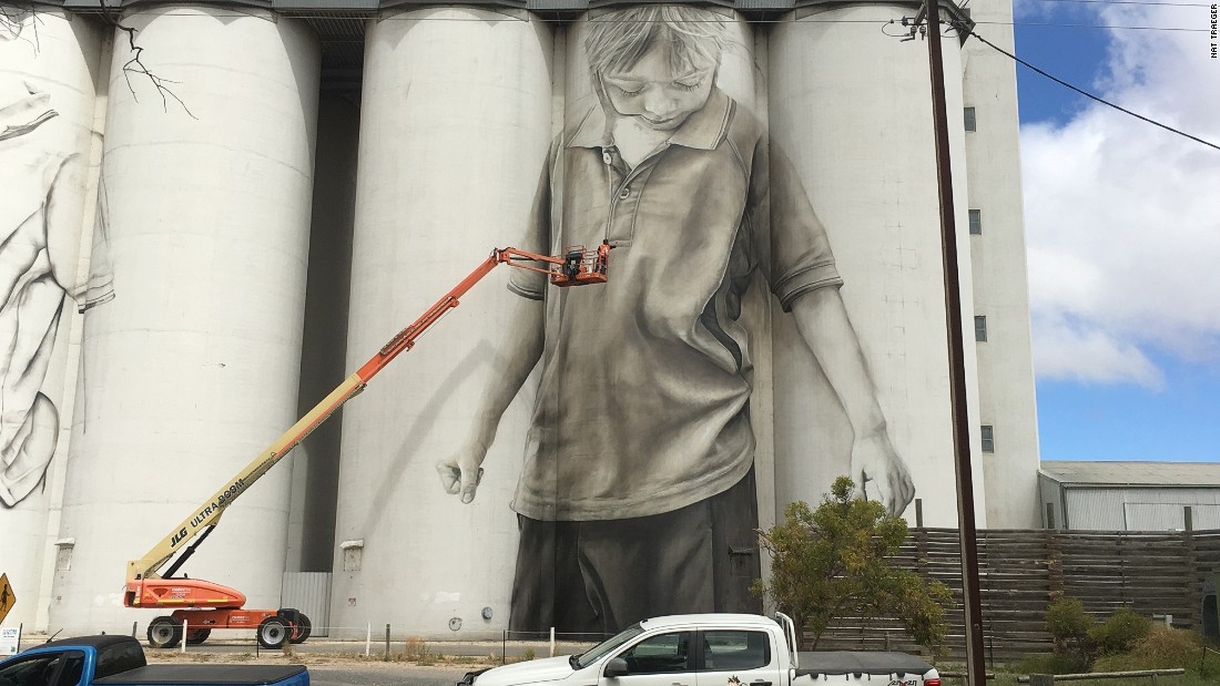 Australian artists Guido van Helten works on his latest mural project, a grain silo in the South Australian town of Coonalpyn.