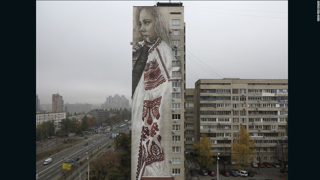 It took van Helten only ten days to paint this mural of a woman in traditional dress in Kiev, Ukraine.