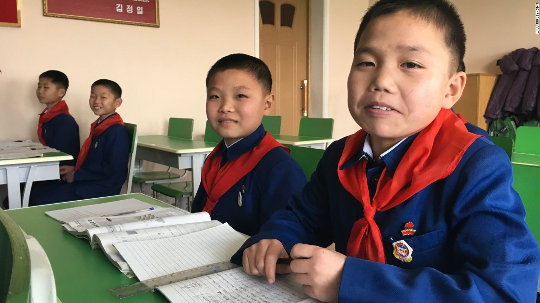 Boys in Pyongyang pose for a photo at a secondary school for orphans on Sunday, February 19.