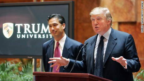 Donald Trump speaks as university president Michael Sexton looks on during a news conference announcing the establishment of Trump University May 23, 2005 in New York City.