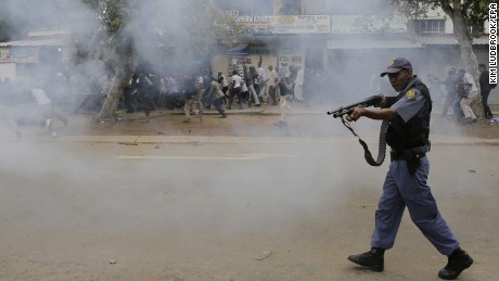 Police forces shot rubber bullets at crowds during a march. Local South African residents have been attacking foreign-owned shops in the city this week, looting goods.