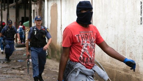 Police follow a South African protester in  the latest wave of anti-immigrant protests to break out in the capital.