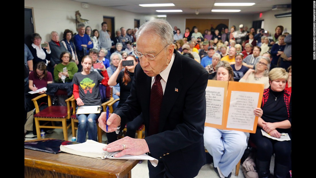 "US Sen. Chuck Grassley writes down issues brought up by constituents during a town-hall meeting in Garner, Iowa, on Tuesday, February 21. Lawmakers across the country have headed back to their districts during the congressional recess, and <a href=""http://www.cnn.com/2017/02/21/politics/chuck-grassley-afghan-man-town-hall/"" target=""_blank"">many are facing tough questions from their constituents.</a>"