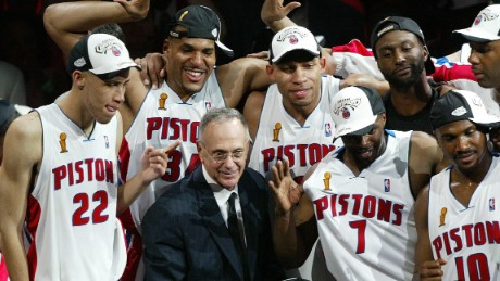 Detroit Piston coach Larry Brown celebrates with players after the Pistons defeated the Lakers 100-87 to win the 2004 NBA championship final, in Auburn Hills, MI, 15 June 2004.