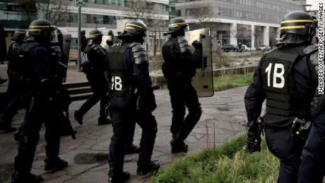 """Anti riot police patrol as people gather in Bobigny, northern Paris, on February 16, 2017 during a demonstration to demand justice for Theo, a 22-year-old youth worker who required surgery after his arrest last week in the gritty suburb of Aulnay-sous-Bois.French President Francois Hollande called for """"justice"""" over the alleged rape of a black youth with a police baton, an incident that has sparked 10 nights of rioting and more than 200 arrests. / AFP / Philippe Lopez        (Photo credit should read PHILIPPE LOPEZ/AFP/Getty Images)"""