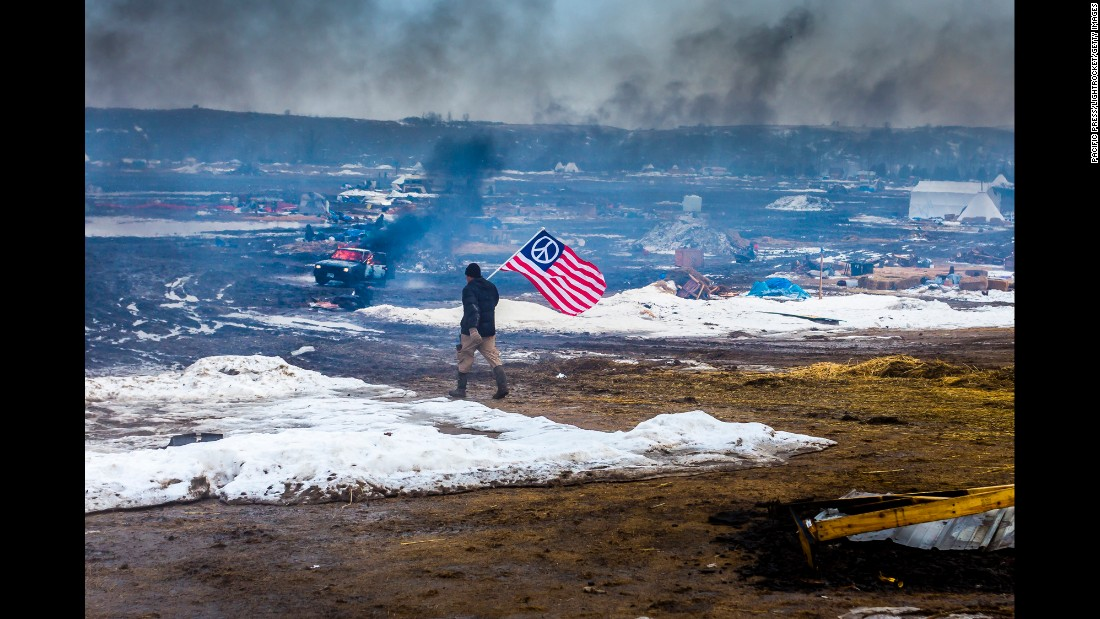 "Smoke rises from the Oceti Sakowin campsite after protesters set their tents on fire Wednesday, February 22, in Cannon Ball, North Dakota. Activists have occupied the area for months to protest the Dakota Access Pipeline, but the state <a href=""http://www.cnn.com/2017/02/22/us/dakota-access-pipeline-evacuation-order/"" target=""_blank"">recently ordered an emergency evacuation</a> to allow private contractors to remove waste from the camp area. One tribal member told CNN that some of the tents were frozen into the ground and had to be burned to be removed. Other members said the fires are part of a tribal tradition."