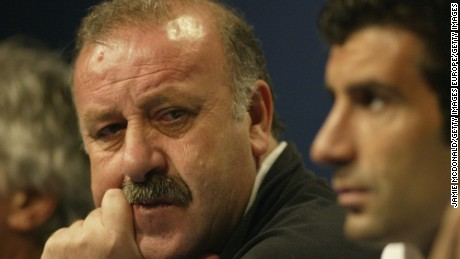 Then-Real Madrid head coach Vicente del Bosque (left) talks to the press as Luis Figo looks on during a press conference at Hampden Park, Glasgow in 2002.