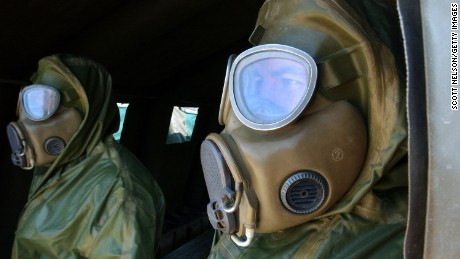 KUWAIT CITY, KUWAIT - DECEMBER 13: Czech soldiers in chemical protection suits take part in a chemical attack response drill conducted at the US Embassy by civil defense authorities and troops from the United States, Germany, and Czech Republic December 13, 2002 in Kuwait City, Kuwait. The exercise, dubbed 'Event Horizon,' was staged to test the coordinated emergency response to a mock attack on the US Embassy in Kuwait by terrorists using deadly sarin nerve gas.