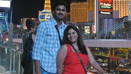 In this undated photo provided by Kranti Shalia, Srinivas Kuchibhotla, left, poses for photo with his wife Sunayana Dumala in Las Vegas.