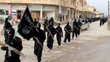 This undated file image posted on a militant website on Tuesday, Jan. 14, 2014, which has been verified and is consistent with other AP reporting, shows fighters from the al-Qaida linked Islamic State of Iraq and the Levant (ISIL), now called the Islamic State group, marching in Raqqa, Syria.