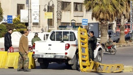 Syrian government forces man a checkpoint at the President square in Homs, the country's third city, on February 25, 2017 as security measures were tightened following a number of suicide attacks.
