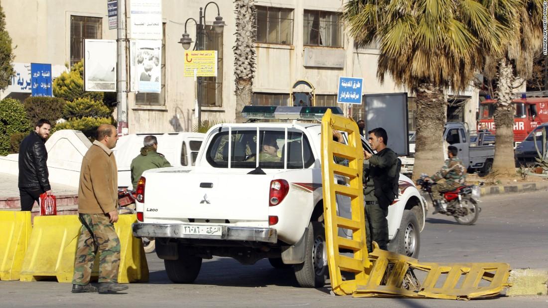 Suicide Attacks Kill Dozens In Syrian City Of Homs