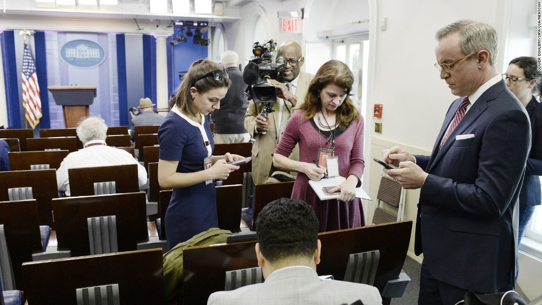 "Reporters stand in the White House press briefing room after being excluded from the meeting on Friday, February 24, in Washington. <a href=""http://money.cnn.com/2017/02/24/media/cnn-blocked-white-house-gaggle/"" target=""_blank"">CNN and other news organizations were blocked</a> Friday from a White House press briefing. The decision struck veteran White House journalists as unprecedented in the modern era."