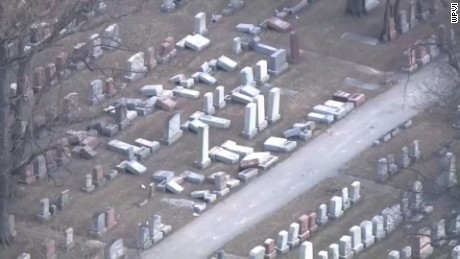 Another view of toppled headstones in Mt. Carmel cemetery.