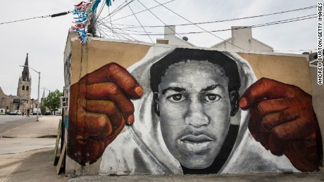 BALTIMORE, MD - APRIL 30:  A mural of Trayvon Martin is seen on the side of a building in the Sandtown neighborhood where Freddie Gray was arrested on April 30, 2015 in Baltimore, Maryland. Gray, 25, was arrested for possessing a switch blade knife April 12 outside the Gilmor Houses housing project on Baltimore's west side. According to his attorney, Gray died a week later in the hospital from a severe spinal cord injury he received while in police custody.  (Photo by Andrew Burton/Getty Images)