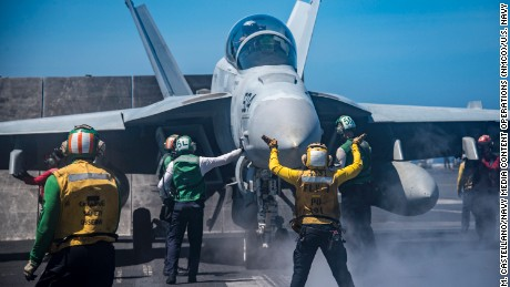 170222-N-BL637-025 SOUTH CHINA SEA (Feb. 22, 2017) Sailors conduct flight operations on the flight deck aboard the aircraft carrier USS Carl Vinson (CVN 70). The ship and its carrier strike group are on a western Pacific deployment as part of the U.S. Pacific Fleet-led initiative to extend the command and control functions of U.S. 3rd Fleet. (U.S. Navy photo by Mass Communication Specialist 2nd Class Sean M. Castellano/Released)