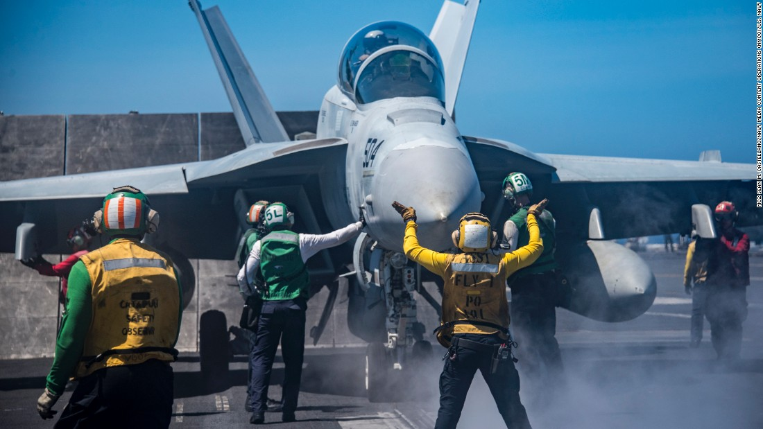 Sailors conduct flight operations on the flight deck aboard the aircraft carrier USS Carl Vinson on February 22.
