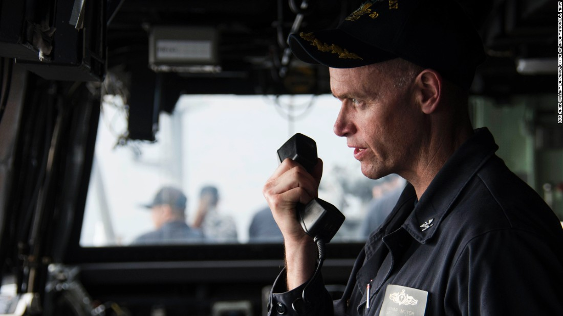 Capt. Nathan Moyer, commanding officer of the amphibious transport dock ship USS Green Bay, communicates with a passing vessel during a replenishment-at-sea with the Military Sealift Command fleet replenishment oiler USNS Tippecanoe on February 7.