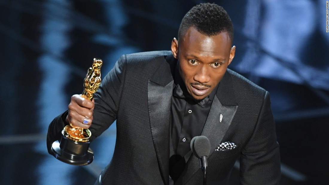 "Mahershala Ali accepts the best supporting actor Oscar for his role in ""Moonlight."""