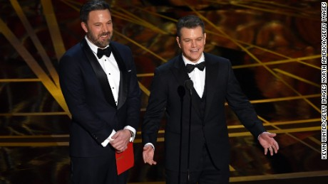 Ben Affleck and Matt Damon speak onstage during the 89th Annual Academy Awards.