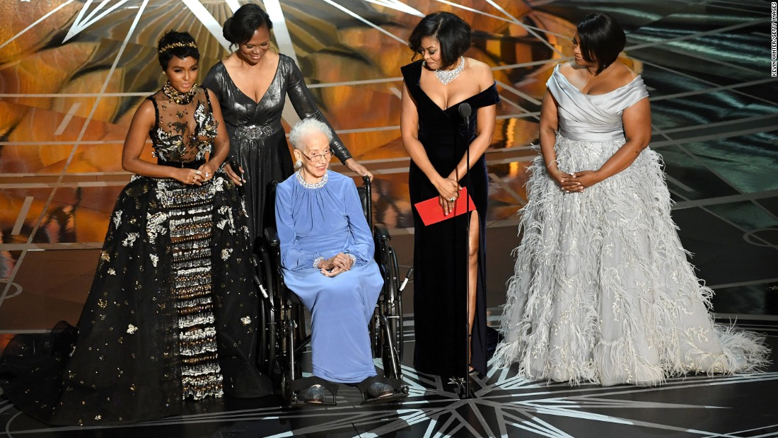 "Former NASA physicist and mathematician Katherine Johnson, third from left, appears on stage with some of the leading ladies of ""Hidden Figures"": Janelle Monae, Taraji P. Henson and Octavia Spencer. ""Hidden Figures"" is a true story about the unsung African-American women whose math and engineering smarts helped power the US space program in the 1960s."