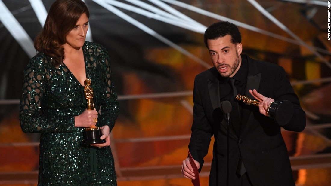 "Director Ezra Edelman delivers a speech next to producer Caroline Waterlow after ""O.J.: Made In America"" won the Oscar for best documentary feature. ""O.J.: Made In America"" was a five-part miniseries that explored the life of former football star O.J. Simpson."