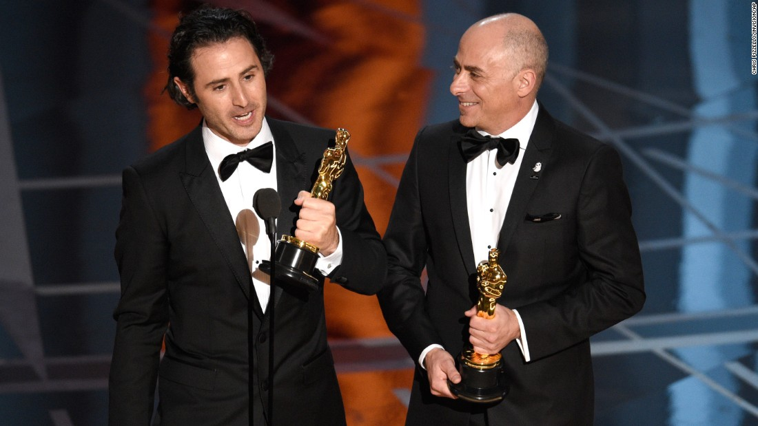 "Alan Barillaro, left, and Marc Sondheimer accept the Oscar for best animated short film  (""Piper"")."
