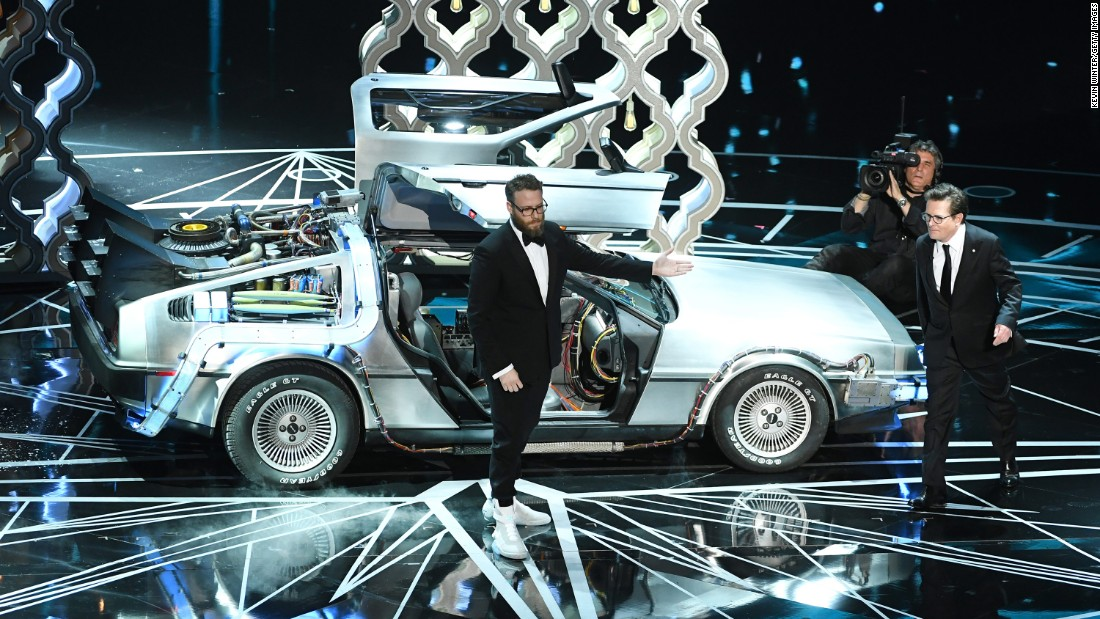 "Seth Rogen, left, and Michael J. Fox were on stage together to present an award. Before that, Rogen paid homage to Fox and the '80s film ""Back to the Future,"" which Rogen said inspired him."